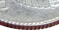 следы соударения штемпеля с гуртильным кольцом